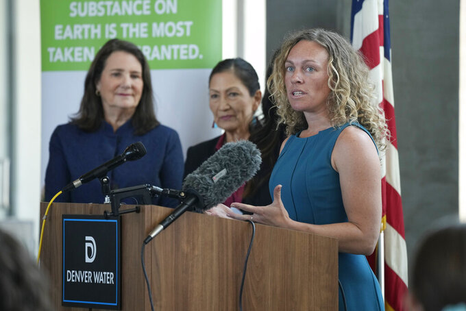 Kate Greenberg, Colorado Commissioner of Agriculture, right, makes a point as U.S. Rep. Diana DeGette, D-Colo., back left, and Interior Secretary Deb Haaland, look on during a news conference after Haaland's visit to talk about federal solutions to ease the effects of the drought at the offices of Denver Water, Thursday, July 22, 2021, in Denver. Haaland will make stops in two cities on Colorado's Western Slope as part of her trip to assess the effects of the drought on the Centennial State. (AP Photo/David Zalubowski)