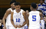 Duke's Javin DeLaurier (12) and RJ Barrett (5) react following a play against Wake Forest during the second half of an NCAA college basketball game in Durham, N.C., Tuesday, March 5, 2019. Duke won 71-70. (AP Photo/Gerry Broome)