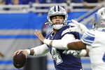 Dallas Cowboys quarterback Dak Prescott (4) is pressured during the first half of an NFL football game against the Detroit Lions, Sunday, Nov. 17, 2019, in Detroit. (AP Photo/Rick Osentoski)