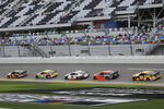 Christopher Bell (95), Kyle Busch (18), Denny Hamlin (11), Martin Truex Jr. (19) and Erik Jones (20) draft each other during a practice session for the NASCAR Daytona 500 auto race Friday, Feb. 14, 2020, at Daytona International Speedway in Daytona Beach, Fla. (AP Photo/Chris O'Meara)