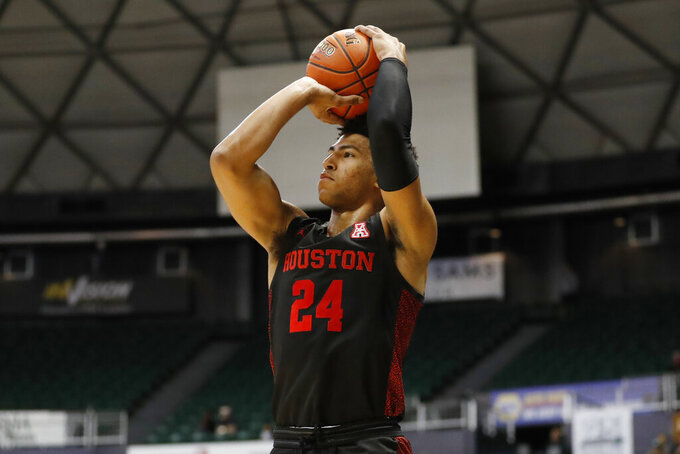 Houston guard Quentin Grimes goes up for a 3-point shot against Washington during the first half of an NCAA college basketball game Wednesday, Dec. 25, 2019, in Honolulu. (AP Photo/Marco Garcia)