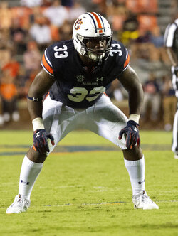 FILE - In this Sept. 8, 2018, file photo, Auburn linebacker K.J. Britt (33) lines up against Alabama State during the second half of an NCAA college football game in Auburn, Ala. The scouts were there in big numbers. But NFL prospects who were timed and tested, poked and prodded at the pro days didn't have the usual contingent of underclassmen looking on and offering their support. (AP Photo/Vasha Hunt, File)