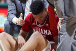 Indiana's Juwan Morgan is tended to after an injury during the first half of an NCAA college basketball game against Michigan State, Saturday, Feb. 2, 2019, in East Lansing, Mich. (AP Photo/Al Goldis)