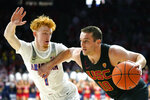 Southern California guard Quinton Adlesh (10) drives against Arizona guard Nico Mannion during the first half of an NCAA college basketball game Thursday, Feb. 6, 2020, in Tucson, Ariz. (AP Photo/Rick Scuteri)