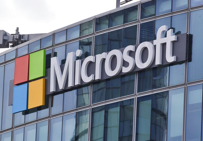 "FILE - This April 12, 2016 file photo shows the Microsoft logo in Issy-les-Moulineaux, outside Paris, France. Microsoft took five hours to resolve a major outage of its workplace applications on Monday, but has not clarified what caused the outage. The company said the outage, which affected users' ability to log into Office 365 applications, began early evening Monday Eastern time. Microsoft did not reply to questions Tuesday, Sept. 29, 2020 about what caused the outage, but said on its service-status Twitter account that it had identified a ""recent change"" that caused problems. (AP Photo/Michel Euler, File)"