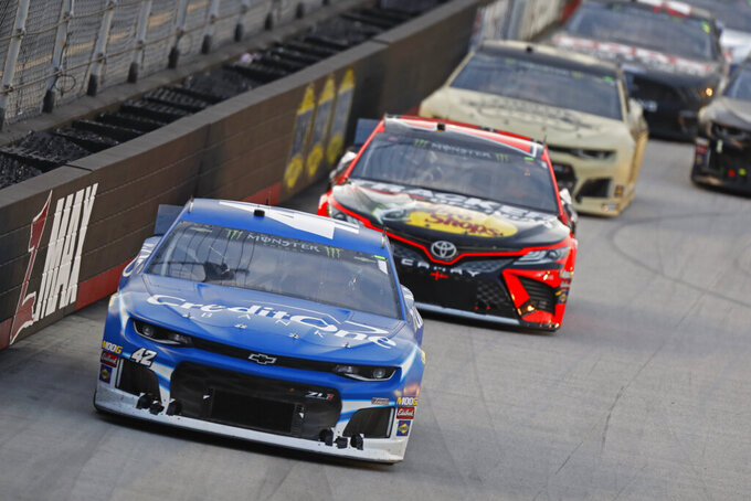 Kyle Larson (42) leads others down the back straight during a NASCAR Cup Series auto race, Saturday, Aug. 17, 2019, in Bristol, Tenn. (AP Photo/Wade Payne)