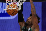Boston Celtics' Marcus Smart (36) dunks the ball during the first half of an NBA conference semifinal playoff basketball game against the Toronto Raptors' Monday, Sept. 7, 2020, in Lake Buena Vista, Fla. (AP Photo/Mark J. Terrill)
