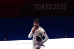 Ka Long Cheung of Hong Kong celebrates defeating Daniele Garozzo of Italy in the men's individual final Foil competition at the 2020 Summer Olympics, Monday, July 26, 2021, in Chiba, Japan. (AP Photo/Hassan Ammar)