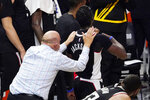 Los Angeles Clippers owner Steve Ballmer pats guard Reggie Jackson on the back after the Clippers defeated the Utah Jazz 131-119 in Game 6 of a second-round NBA basketball playoff series against the Utah Jazz Friday, June 18, 2021, in Los Angeles. (AP Photo/Mark J. Terrill)