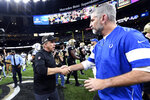 New Orleans Saints head coach Sean Payton, left, greets Indianapolis Colts head coach Frank Reich after an NFL football game in New Orleans, Monday, Dec. 16, 2019. The Saints won 34-7. (AP Photo/Bill Feig)