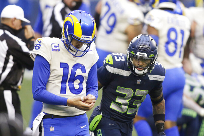 Seattle Seahawks strong safety Jamal Adams (33) looks at Los Angeles Rams quarterback Jared Goff during the second half of an NFL wild-card playoff football game, Saturday, Jan. 9, 2021, in Seattle. (AP Photo/Scott Eklund)