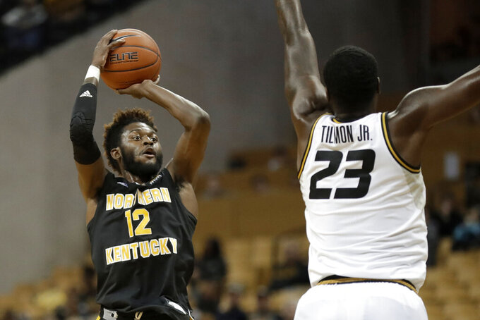 Northern Kentucky's Trevon Faulkner (12) shoots over Missouri's Jeremiah Tilmon (23) during the first half of an NCAA college basketball game Friday, Nov. 8, 2019, in Columbia, Mo. (AP Photo/Jeff Roberson)