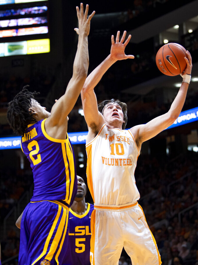 Tennessee forward John Fulkerson (10) attempts a shot against LSU during an NCAA college basketball game at Thompson-Boling Arena, Saturday, Jan. 4, 2020,  Knoxville, Tenn. (Brianna Paciorka//Knoxville News Sentinel via AP)