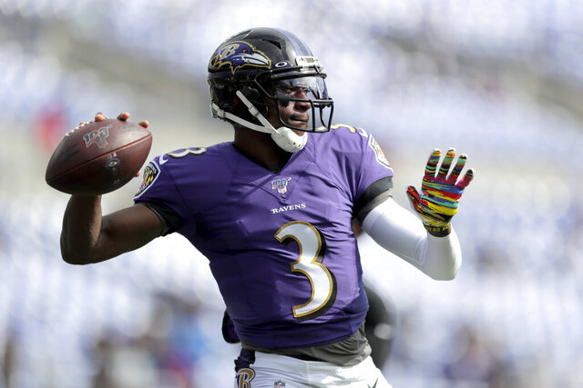 FILE - In this Oct. 13, 2019, file photo Baltimore Ravens quarterback Robert Griffin III works out prior to an NFL football game against the Cincinnati Bengals in Baltimore. It will be Griffin's first NFL start since 2016 on Sunday, Dec. 29. (AP Photo/Julio Cortez, File)