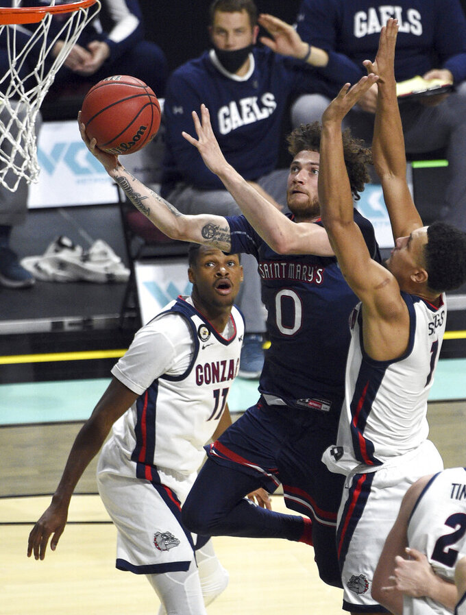 Saint Mary's guard Logan Johnson (0) lays up the ball against Gonzaga during the second half of an NCAA semifinal college basketball game at the West Coast Conference tournament Monday, March 8, 2021, in Las Vegas. (AP Photo/David Becker)