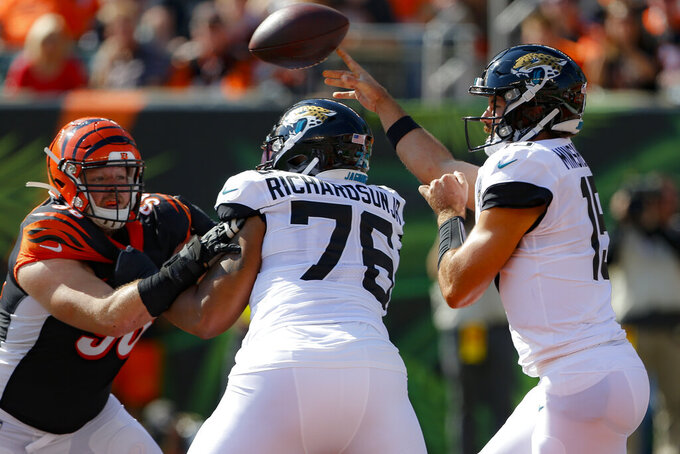Jacksonville Jaguars quarterback Gardner Minshew (15) passes in the first half of an NFL football game against the Cincinnati Bengals, Sunday, Oct. 20, 2019, in Cincinnati. (AP Photo/Gary Landers)