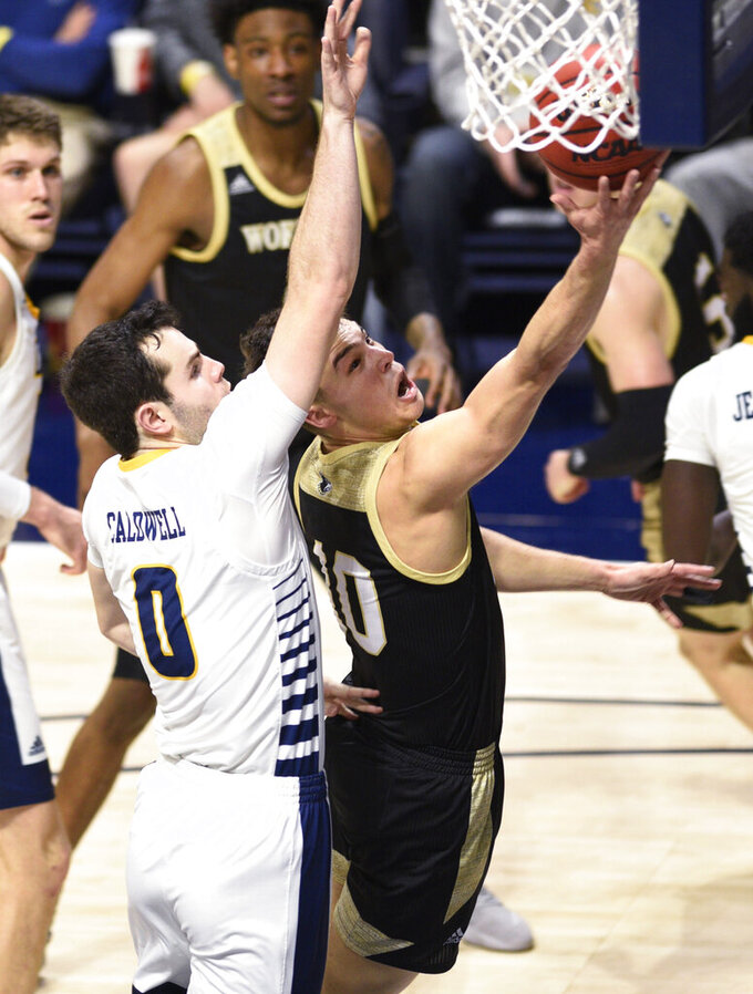 Wofford's Nathan Hoover (10) drives to the basket past Chattanooga's A.J. Caldwell (0) during an NCAA college basketball game Wednesday, Jan. 15, 2020, in Chattanooga, Tenn. (Robin Rudd/Chattanooga Times Free Press via AP)