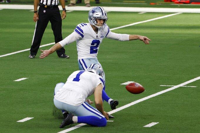 Dallas Cowboys' Hunter Niswander (1) holds as place kicker Greg Zuerlein (2) kicks a field goal in the first half of an NFL football game against the Philadelphia Eagles in Arlington, Texas, Sunday, Dec. 27. 2020. (AP Photo/Ron Jenkins)
