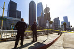 Los Angeles Police officers watch over a closed street parallel to the Harbor Freeway ramp, during the visit of President Donald Trump in Los Angeles, Tuesday, Sept. 17, 2019. Trump began a California visit on Tuesday, saying he will do