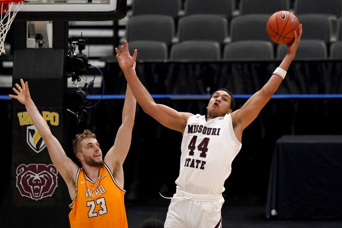 Missouri State's Gaige Prim (44) reaches for a rebound as Valparaiso's Ben Krikke (23) watches during the second half of an NCAA college basketball game in the quarterfinal round of the Missouri Valley Conference men's tournament Friday, March 5, 2021, in St. Louis. (AP Photo/Jeff Roberson)