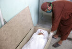 The body of Nimat Rawan, a former Afghan TV presenter, lies in morgue at a hospital in Kandahar, Afghanistan, Tuesday, May 6, 2021. Gunmen killed Rawan on Thursday as he was traveling in the southern city of Kandahar, a provincial official said, adding to fears for press freedom in the war-wrecked country. (AP Photo/Sidiqullah Khan)