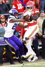 Kansas City Chiefs wide receiver Tyreek Hill (10) makes a 41-yard catch against Minnesota Vikings cornerback Trae Waynes (26) during the second half of an NFL football game in Kansas City, Mo., Sunday, Nov. 3, 2019. (AP Photo/Reed Hoffmann)