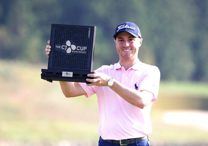 Justin Thomas of the United States poses with his trophy after winning the CJ Cup PGA golf tournament at Nine Bridges on Jeju Island, South Korea, Sunday, Oct. 20, 2019. (Park Ji-ho/Yonhap via AP)