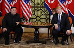 FILE - In this Feb. 28, 2019, file photo, President Donald Trump, right, meets North Korean leader Kim Jong Un in Hanoi. Fears rise that North Korea's year-end deadline to the U.S. to offer some new initiative to the nuclear-standoff means that nearly two years of head-spinning diplomatic engagement might be in danger of falling apart. (AP Photo/Evan Vucci, File)