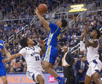Nevada guard Jazz Johnson (22) and San Jose State guard Zach Chappell (4) go after a loose ball during the first half of an NCAA college basketball game in Reno, Nev., Wednesday, Jan. 9, 2019. (AP Photo/Tom R. Smedes)