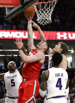 Ohio State forward Kyle Young (25) shoots against Northwestern center Dererk Pardon (5), forward Miller Kopp and forward Vic Law (4) during the first half of an NCAA college basketball game Wednesday, March 6, 2019, in Evanston, Ill. (AP Photo/Nam Y. Huh)