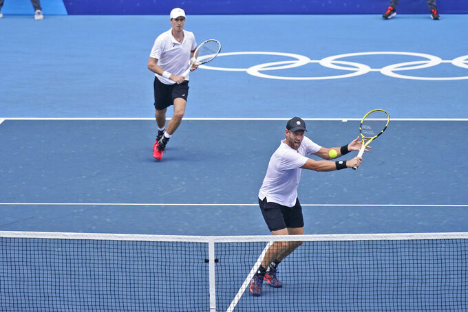 The New Zealand doubles team of Michael Venus, right, and Marcus Daniell play during the men's doubles bronze medal match of the tennis competition at the 2020 Summer Olympics, Friday, July 30, 2021, in Tokyo, Japan. (AP Photo/Seth Wenig)