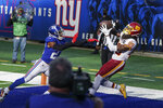 Washington Football Team wide receiver Cam Sims (89) catches a pass for a touchdown in front of New York Giants' Logan Ryan (23) during the second half of an NFL football game Sunday, Oct. 18, 2020, in East Rutherford, N.J. The Giants won 20-19. (AP Photo/John Minchillo)