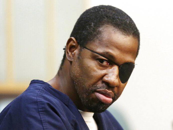 FILE - In this Feb. 22, 2017, Markeith Loyd looks toward family members during court proceedings at his arraignment in Orlando, Fla. Loyd, accused of killing his pregnant ex-girlfriend and a Florida police officer has been found competent to stand trial, Friday, Aug. 23, 2019. (Red Huber/Orlando Sentinel via AP, File)