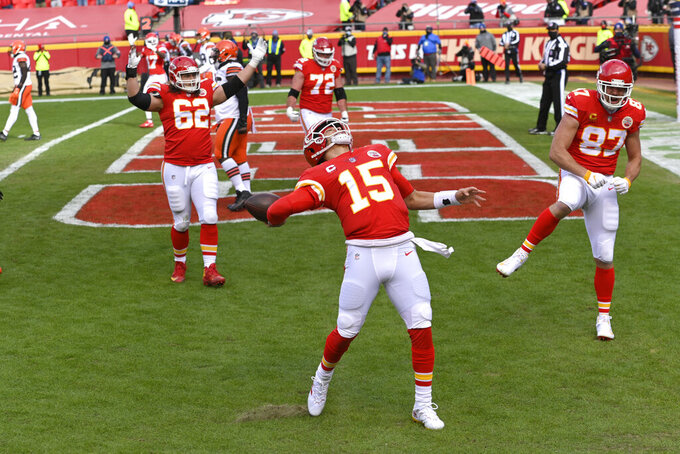 Kansas City Chiefs quarterback Patrick Mahomes (15) celebrates after scoring on a touchdown run during the first half of an NFL divisional round football game against the Cleveland Browns, Sunday, Jan. 17, 2021, in Kansas City. (AP Photo/Reed Hoffmann)