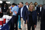 First lady Jill Biden and Doug Emhoff attend a COVID-19 vaccination event at Minute Maid Park, in Houston, Tuesday, June 29, 2021. (AP Photo/Carolyn Kaster, Pool)