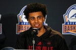 Louisville basketball player Jordan Nwora answers a question during the Atlantic Coast Conference NCAA college basketball media day in Charlotte, N.C., Tuesday, Oct. 8, 2019. (AP Photo/Nell Redmond)