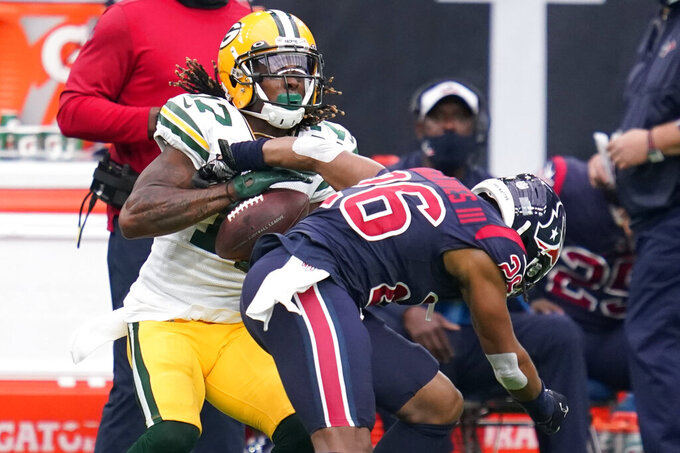Green Bay Packers wide receiver Davante Adams, left, catches a ball for a first down as Houston Texans cornerback Vernon Hargreaves III (26) defends during the first half of an NFL football game Sunday, Oct. 25, 2020, in Houston. (AP Photo/Sam Craft)