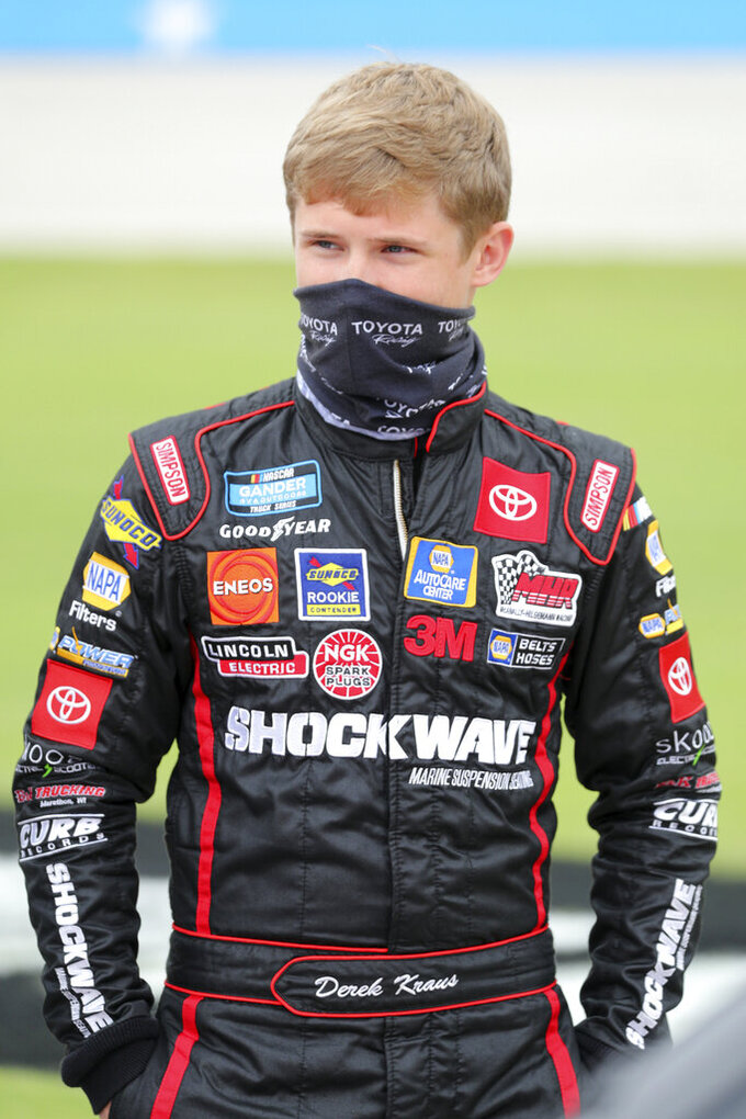 NASCAR Texas Trucks Series driver Derek Kraus (19) stands on pit road before a NASCAR Cup Series auto race at Texas Motor Speedway in Fort Worth, Texas, Sunday, Oct. 25, 2020. (AP Photo/Richard W. Rodriguez)