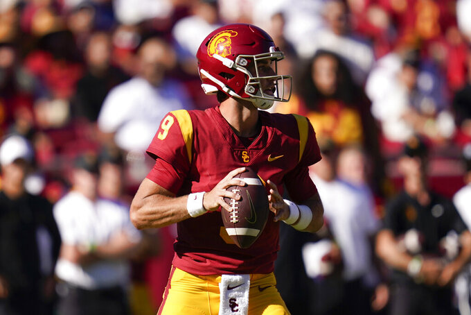 Southern California quarterback Kedon Slovis (9) looks for a receiver during the second half of an NCAA college football game against San Jose State Saturday, Sept. 4, 2021, in Los Angeles. (AP Photo/Ashley Landis)