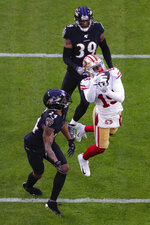San Francisco 49ers wide receiver Deebo Samuel (19) makes a touchdown catch against Baltimore Ravens cornerback Marcus Peters (24) and cornerback Brandon Carr in the first half of an NFL football game, Sunday, Dec. 1, 2019, in Baltimore, Md. (AP Photo/Julio Cortez)