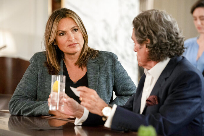 This image released by NBC shows Mariska Hargitay, left, and Ian McShane in a scene from