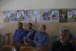 Mourners sit next to posters of 17-year-old Palestinian Mohammad Hamayel, in the village of Beita, south of the West Bank city of Nablus. Monday, June 14, 2021. Hamayel was killed during clashes with Israeli forces following a protest against the wildcat Jewish settlement of Eviatar that was established last month without the permission of Israeli authorities on land the Palestinians say is privately owned. (AP Photo/Majdi Mohammed)