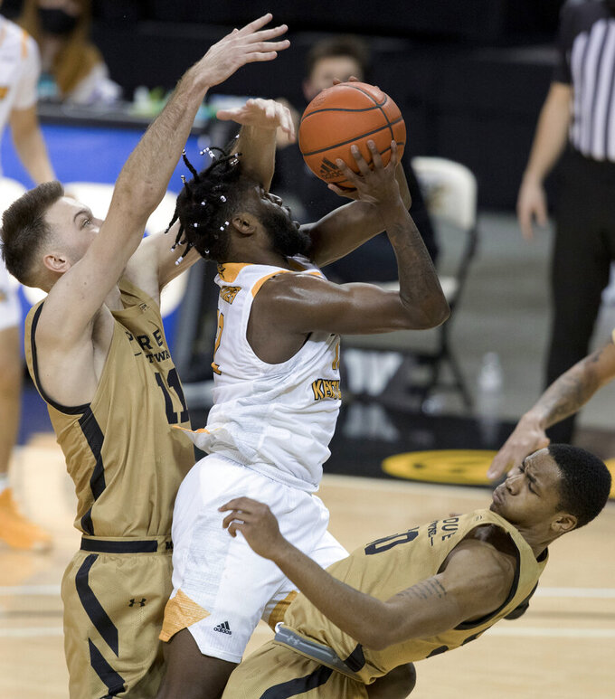 Purdue-Fort Wayne guard Jalon Pipkins (50) draws a foul by Northern Kentucky guard Trevon Faulkner (12) as Purdue forward Dylan Carl (11) defends during the second half of an NCAA college basketball game Friday, Jan. 1, 2021, in Highland Heights, Ky. (Albert Cesare/The Cincinnati Enquirer via AP)