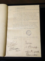 This Tuesday, Oct. 30, 2018 photo shows the Armistice document signed by the Allies and the Germans in a carriage in Rethondes, north of Paris, at 05:00 am on Nov. 11, 1918. The document is displayed at the Vincennes castle museum in Vincennes, outside Paris, France. The Allies signed the Armistice on Nov. 11, 1918 in a train carriage in Compiegne, north of Paris, that ended hostilities with Germany and put an end to the atrocities of World War I. (AP Photo/Michel Euler)