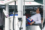 Graham Rahal relaxes in the pit area during practice for the Indianapolis 500 auto race at Indianapolis Motor Speedway in Indianapolis, Thursday, May 20, 2021. (AP Photo/Michael Conroy)