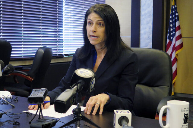 FILE - In this March 5, 2020, file photo, Michigan Attorney General Dana Nessel addresses the media during a news conference in Lansing, Mich. Nessel opened an investigation Monday, Sept. 28, 2020, into allegations that a ballot group may have committed crimes while gathering signatures to repeal a law that gives Gov. Gretchen Whitmer broad powers to manage the coronavirus crisis. Nessel, a Democrat, said her office will probe Unlock Michigan, a Republican-affiliated committee that plans to submit its signatures Friday. If the group turns in enough — it needs 340,000 valid signatures — the initiative will go to the Legislature. (AP Photo/David Eggert, File)