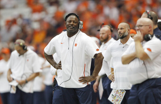 Syracuse head coach Dino Babers reacts late in the fourth quarter of an NCAA college football game against Florida State in Syracuse, N.Y., Saturday, Sept. 15, 2018. Syracuse won 30-7. (AP Photo/Nick Lisi)