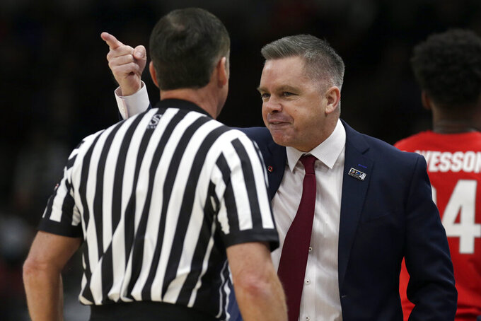 Ohio State head coach Chris Holtmann argues a call during the first half of an NCAA college basketball game against Michigan State in the quarterfinals of the Big Ten Conference tournament, Friday, March 15, 2019, in Chicago. (AP Photo/Kiichiro Sato)