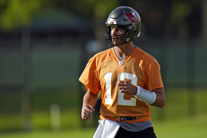 Tampa Bay Buccaneers quarterback Tom Brady (12) runs during an NFL football practice Tuesday, July 27, 2021, in Tampa, Fla. (AP Photo/Chris O'Meara)