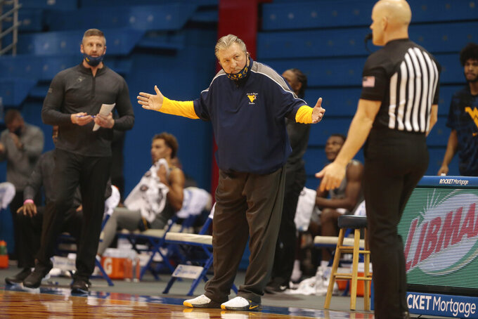 West Virginia coach Bob Huggins reacts to a call in the first half of an NCAA college basketball game against Kansas, Tuesday, Dec. 22, 2020, in Lawrence, Kan. (Evert Nelson/The Topeka Capital-Journal via AP)